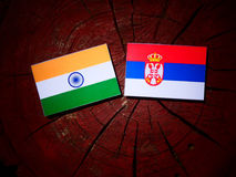 Indian flag with Serbian flag on a tree stump isolated. Indian flag with Serbian flag on a tree stump stock images