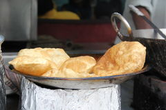 Indian flat bread Puri. Hot traditional Indian flat bread Puri in india Royalty Free Stock Photos