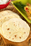 Indian Flatbread Called Chapati. On wooden board (Selective Focus, Focus on the big brown spot on the left Stock Photo
