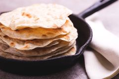 Indian flatbread chapati, green onion. Color surge trend. Traditional Kerala Indian cuisine. Homemade flatbread chapati on gray slate background. Copyspace stock photo
