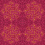 Indian Floral Pattern. Traditional Indian pattern with round floral elements. Golden and dark purple motifs on purple background. Seamless repeat Stock Image