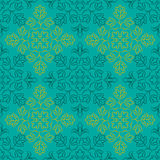 Indian Floral Pattern. Traditional Indian pattern with round floral elements. Golden and dark turquoise elements on turquoise background. Seamless repeat Royalty Free Stock Images