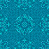 Indian Floral Pattern. Traditional Indian pattern with round floral elements in shades of blue. Seamless repeat Stock Image