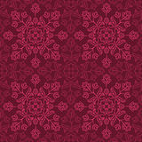 Indian Floral Pattern. Traditional Indian pattern with round floral elements in shades of purple. Seamless repeat Royalty Free Stock Photo