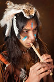 Indian with flute Royalty Free Stock Image