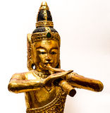 Indian with Flute. Wooden figure gilt in gold Stock Image