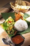 Indian food. Vibrant indian food served with banana leaves Royalty Free Stock Images