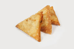 Indian Food. One Bite Indian Samosa Close up stock photos