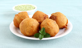 Indian Food Aloo Vada. Indian vegetarian food aloo vada, a traditional and popular snack, made from deep frying portions of chickpea flour, vegetables and mashed Stock Images