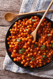 Indian Food Chana masala on a table close-up. Vertical top view Stock Images
