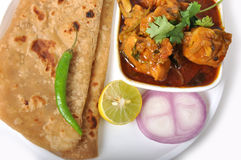 Indian Food - Chapati & Chicken. Closeup shot of chapati with chicken, onion, lemon and green pepper Stock Photo