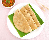 Indian Food Chapati. Or Indian flat bread, placed folded on a banana leaf, is made from wheat flour dough and is a traditional and popular cuisine Stock Images