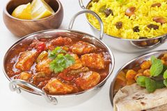 Indian Food Chicken Jalfrezi Curry and Yellow Rice Pillau. Indian Food - Chicken Jalfrezi with pillau rice and chapatis. This curry was invented by Indian chefs Stock Photography