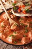Indian food chicken tikka masala macro on a plate. Vertical Stock Image