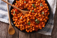 Indian Food: chickpeas in curry sauce close-up. Horizontal top v Royalty Free Stock Photo