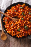 Indian Food: chickpeas in curry sauce close-up. Vertical top vie Stock Photography