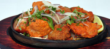 Indian food. On a bowl on a wooden plate Royalty Free Stock Images