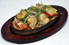 Indian food on bowl. Indian food in an bowl on a wooden holder Royalty Free Stock Photos