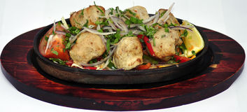 Indian food on wooden plate. Indian food in a bowl on wooden plate Royalty Free Stock Photos