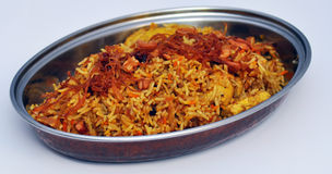 Traditional Indian food in dish. Traditional Indian rice food in metal dish, white background Stock Photo