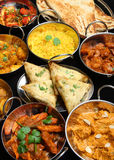 Indian Food Curry Banquet. Selection of Indian food including curries, rice, samosas and naan bread Stock Image