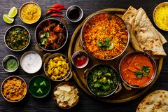 Free Indian Food Curry Butter Chicken, Palak Paneer, Chiken Tikka, Biryani, Vegetable Curry, Papad, Dal, Palak Sabji, Jira Alu Royalty Free Stock Photo - 138549925