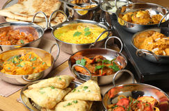 Indian Food Curry Meal Dishes. Selection of Indian food including curries, rice, samosas and naan bread Stock Photo