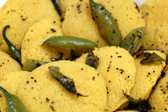 Indian Food Delicacy Dish Dhokla. An exquisite Indian dish - Dhokla .topped with sesame seeds and green chillies Stock Image