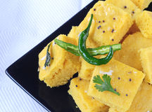 Indian Food Dhokla. Indian snack Dhokla with chilly Stock Photos