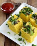Indian Food Dhokla. Indian snack Dhokla with chilly Stock Photo