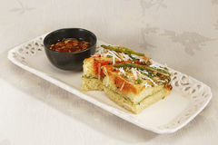 Indian Food Dhokla topped with sesame seeds and green chilly Royalty Free Stock Photo