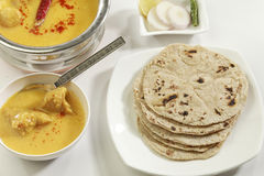 Indian Food: Kadhi with gatte and chapatti or roti. Stock Photo