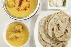 Indian Food: Kadhi with gatte and chapatti or roti. Royalty Free Stock Images