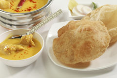 Indian Food: Kadhi with gatte and deep fried Puri. Royalty Free Stock Photography