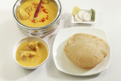 Indian Food: Kadhi with gatte and deep fried Puri. Stock Images