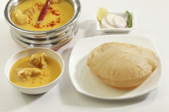 Indian Food: Kadhi with gatte and deep fried Puri. Royalty Free Stock Photo