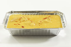 Indian Food- Kadhi with gatte in metal tray. Royalty Free Stock Image