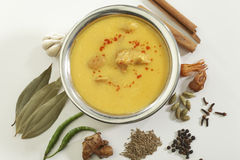 Indian Food- Kadhi with gatte in stainless steel pot with spices. Stock Photo