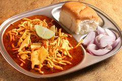 Indian Food - Maharashtrian Misal Pav. Spicy Maharashtrian curry usually consumed with a bread, onion and a squeeze of lemon. Full dish Stock Image
