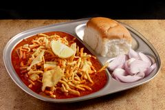 Indian Food - Maharashtrian Misal Pav. Spicy Maharashtrian curry usually consumed with a bread, onion and a squeeze of lemon Royalty Free Stock Images