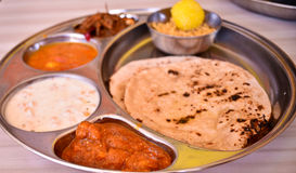 Indian food. Indian meal (Thali) consisting of different curry,flat bread from the state of rajasthan Stock Images