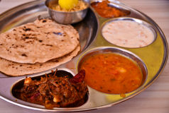 Indian food. Indian meal (Thali) consisting of different curry,flat bread from the state of rajasthan Royalty Free Stock Photography