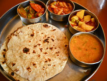 Indian food. Indian meal (Thali) consisting of different curry,flat bread from the state of rajasthan Royalty Free Stock Photo