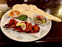 Indian food naan bread and chicken plate. Indian food plate naan curry and chicken Royalty Free Stock Photography