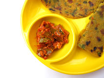 Indian Food-Pickle and Methi Paratha. Pickle is made of mango fruit and spices served with hot fried methi parathas Royalty Free Stock Images