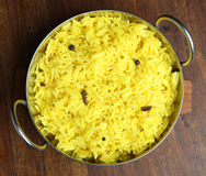 Indian Food, Pilau Rice. Indian pilau rice with visible spices in metal serving dish Royalty Free Stock Images