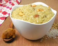 Indian Food Pongal. Indian food sweet pongal. It is a vegetarian, traditional, popular and healthy dish made from rice, mung, jaggery, cashew nuts and raisins Stock Photos
