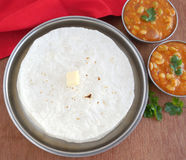 Indian Food Rice Roti. Or rice flat bread, with field beans curry, a traditional, popular and vegetarian dish, is made from rice flour dough Stock Photo