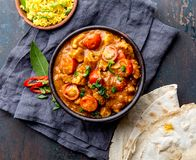 INDIAN FOOD. ROGAN JOSH curry sauce. Pork rogan josh with rice and naan bread stock photography