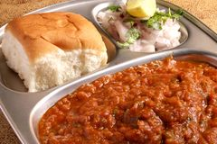 Indian Food - Street Food - Pav Bhaji. Pav Bhaji, a very popular Indian street food, especially popular in Mumbai. Mixed Vegetable Mashed into a Gravy, consumed Stock Photo